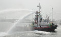 Fireboat Omeed Taher sprays water during a training exercise in Kuwait.jpg