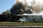 Firefighters work to put out the flames after a hijacked jetliner crashed into the Pentagon at approximately 0930 on September 11, 2001 010911-M-CI426-057.jpg