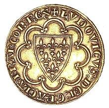 Photo d'une pièce de monnaie figurant un écu fleurdelisé dans un octolobe, le tout entouré d'un texte en latin