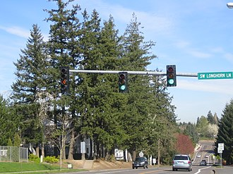 Traffic-light signalling and operation - A pole-mounted flashing left turn signal in Oregon