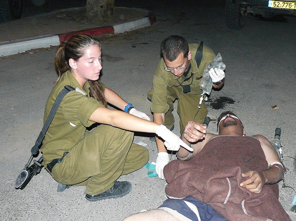 Flickr - Israel Defense Forces - IDF Soldiers Treats Palestinian Man