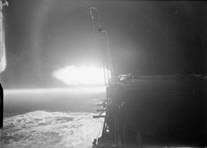 Formidable lit up by the flashes of her 4.5 inch guns at night.jpg