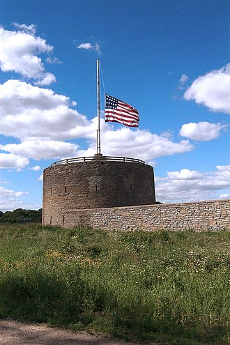 Fort Snelling (unorganized territory), Minnesota - View of the Round Tower. The flag is at half-staff because former American President Ronald Reagan had died just prior to the day the photograph was taken.