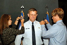 Gorenc, as commander of the Air Force District of Washington, receives two star epaulets from his children, during his promotion ceremony.