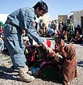 Friendly Afghan police officer and Afghan girls celebrate the opening of a new girls' school in Helmand.jpg