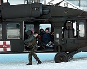 A Blackhawk helicopter as the crew prepares to evacuate tourists stranded by an avalanche in Galtür, Austria, on February 25, 1999.