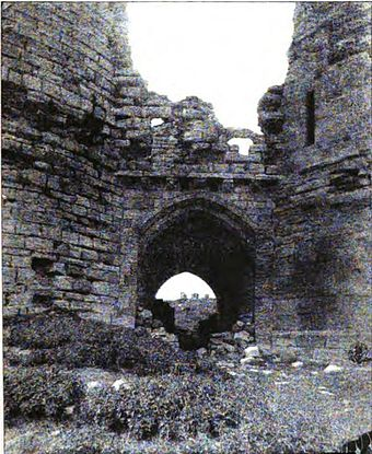 The Great Gatehouse in 1884, showing the partially-blocked passageway Gatehouse of Dunstanburgh Castle, 1884.jpg