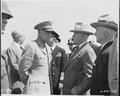 Gen. Dwight D. Eisenhower chats with President Harry S. Truman at an airfield in Brussels, Belgium where the... - NARA - 198777.tif