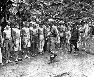 Robert Blake (USMC) - General Robert Blake inspects Japanese troops on Dublon island, Truk, on 4 October 1945. The by-passed Japanese were facing starvation before their surrender.