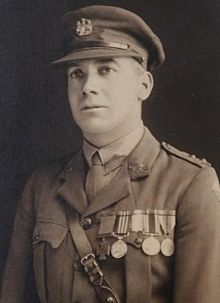 A head and shoulders portrait of a man in military uniform wearing medals.