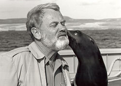 GiGi, a sea lion trained by the U.S. Navy for underwater recovery, nuzzles merchant mariner Capt. Arne Willehag of the USNS Sioux during a 1983 training session.