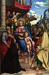 Girolamo da Treviso Madonna with Angels, Saints and a Donor.jpg