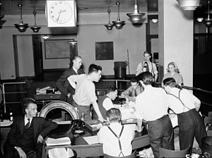 History of Canadian newspapers - Globe and Mail staff await news of the D-Day invasion. June 6, 1944.