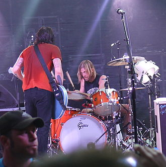 Taylor Hawkins - Hawkins (behind the drums) playing with Foo Fighters in Austin, Texas