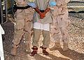 Guards prepare to escort a Guantanamo captive to the Camp Four medical facility on Nov 23 2007 -2.jpg