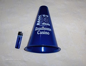Megaphone - A small sports megaphone for cheering at sporting events, next to a 3 in. cigarette lighter for scale