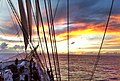 Half way across the Atlantic Ocean on a Clipper Tall Ship - Canaries to Barbados Transatlantic crossing sunset at 19.13N ^ 42.06W - panoramio.jpg