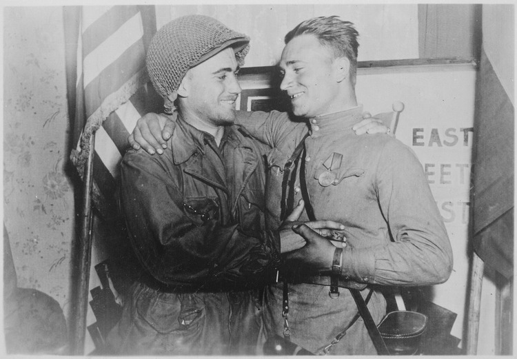 Happy 2nd Lieutenant William Robertson and Lt. Alexander Sylvashko, Russian Army, shown in front of sign
