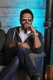 Abhishek Bachchan in dark glasses, with a microphone