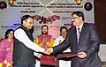 Harsh Vardhan and the Union Minister for Human Resource Development, Shri Prakash Javadekar witnessing the exchange of signed MoU between Council of Scientific and Industrial Research (CSIR) and Kendriya Vidyalaya Sangathan.jpg