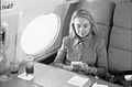 Hillary Rodham Clinton on plane using Game Boy (09).jpg