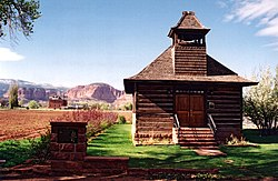 A Utah historic site, this old log schoolhouse with its bell tower and red sandstone steps is a reminder of Torrey's pioneer heritage.