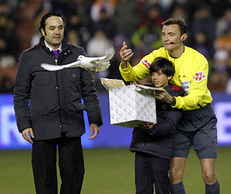 Miguel Delibes - The events in memory of the writer in Valladolid during the weekend following his death. In the picture, Mejuto González, referee of the Spanish first league match between Real Valladolid and Real Madrid, accompanies the grandson of the writer at the release of a white dove as a tribute to Miguel Delibes.