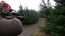 Hunter taking aim during a driven hunt Sweden 01.png