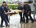 IAF personnel carry an injured pilgrim on s stretcher in Dehradun, on their rescue work in flood-hit Uttarakhand.jpg
