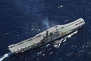 India's light carrier INS Viraat, formerly HMS Hermes, purchased from the British, after INS Vikrant shows another example of the ski-jump.