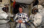 ISS-47 Tim Peake wears a Sokol pressure suit in the Quest airlock.jpg