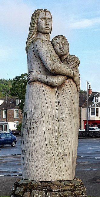 Kirkcudbright - 1994 wooden sculpture In Memory Of Loved Ones Lost At Sea by Charlie Easterfield in Kirkcudbright harbour
