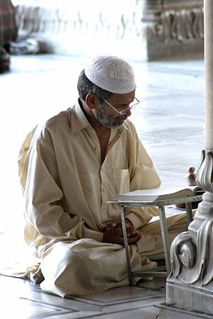 Taqiyah (cap) - A man wearing a crochet taqiyah and kurta in Pakistan