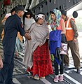 Injured rescued persons from quake-hit Nepal are de-boarding from an IAF transport aircraft, at Palam airport, in New Delhi.jpg