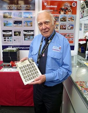 Isle of Man Post Office - An Isle of Man Post Office employee with a sheet of stamps issued in 2015 to mark the 175th anniversary of the issue of the Penny Black.