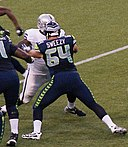 J. R. Sweezy blocking a Raider.jpg