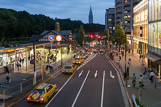 Harajuku - JR Harajuku Station (left), with Meiji Shrine forest as background