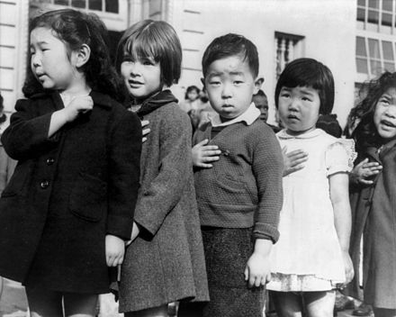 Children at the Weill public school in San Francisco pledge allegiance to the American flag in April 1942, prior to the internment of Japanese Americans JapaneseAmericansChildrenPledgingAllegiance1942-2.jpg