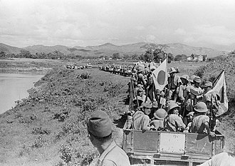Japanese invasion of French Indochina - Japanese Imperial Army soldiers advance to Lang Son, in September 1940 in French Indochina.