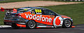 Jenson Button doing a lap in Triple Eight Racing VE Holden Commodore V8 Supercar on the Mount Panorama Circuit.jpg