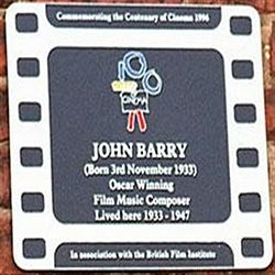 Photo of John Barry film cell plaque