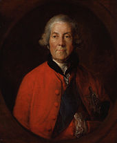 elderly man in a grey wig and red coat