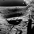 John Young stands on the rim of Plum Crater while collecting lunar samples.jpg
