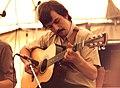 "Jon Burge, UK folk musician on stage with ""Crows"", Towersey, 1980.jpg"