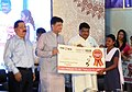 Jual Oram and the Minister of State for Power, Coal, New and Renewable Energy and Mines (Independent Charge), Shri Piyush Goyal presenting the scholarship to school students under NALCO Ki Ladli project.jpg