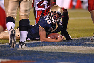 Two-point conversion - Navy quarterback Kaipo-Noa Kaheaku-Enhada puts the ball over the goal line for a two-point conversion against the Utah Utes, 2007