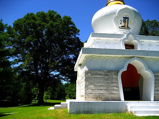 "Stupa on the grounds of Tibetan Mongolian Buddhist Cultural Center, Bloomington, Indiana. The Dalai Lama performed the initiation here in 1999, ""to promote world peace."" Kalacakra stupa.jpg"