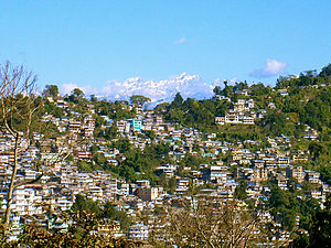 Sivalik Hills - Kalimpong town as viewed from a distant hill. In the background are the Himalayas.