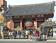 Rickshaws carry tourists in front of Kaminarimon Gate of Sensoji in Asakusa