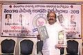 Kavi Siddartha With his Book Bommalabavi & Telangana Sathiya Academy Award 2019.jpg